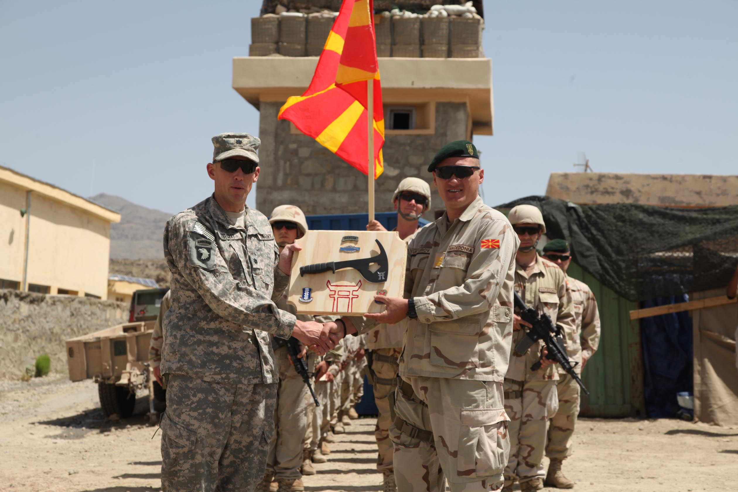 Afghanistan - U.S. Army Lt. Col. David Fivecoat, 3rd Battalion, 187th Infantry Regiment Commander, from Delaware, Ohio, presents Macedonian Capt. Borche Turturov